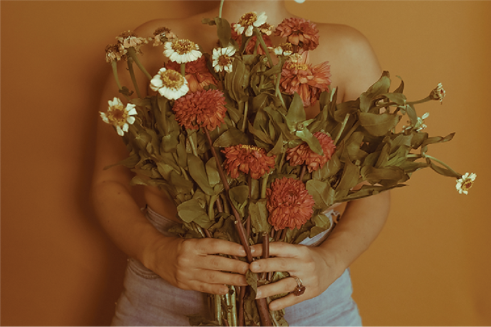 girl-holding-flowers.png