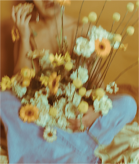 blurry-girl-holding-flowers.png