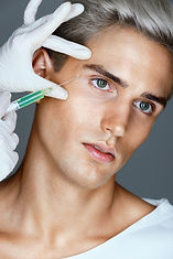 Attractive man receiving botox injection