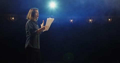 Medium close-up of an actress rehearsing