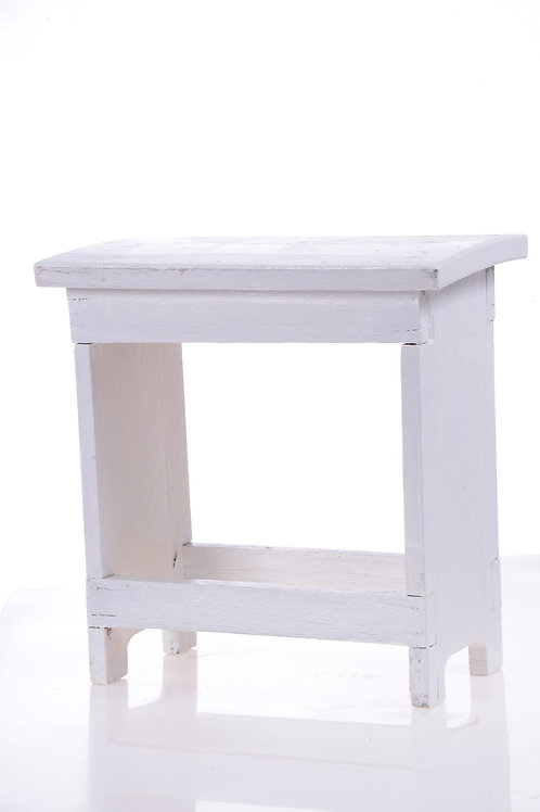 White timber milking stool