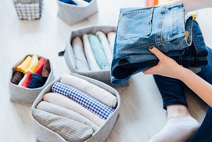 Woman folding clothes, organizing stuff