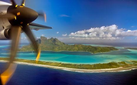 Aerial view of Bora Bora and plane prope