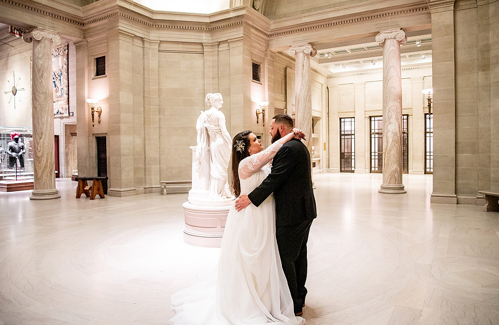 bride and groom dance together in cleveland museum of art gallery