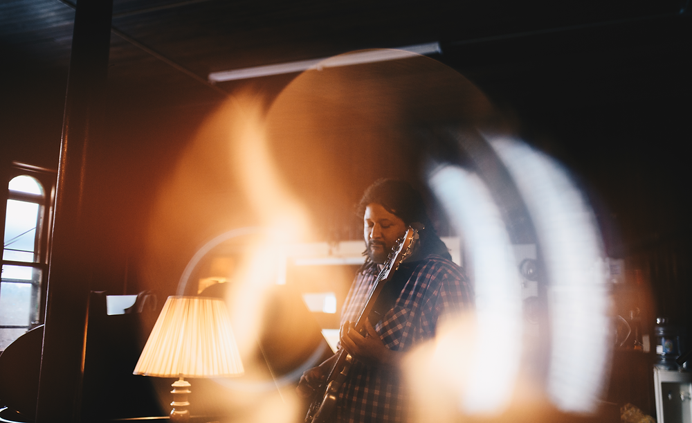 light rings around guitar player in studio setting