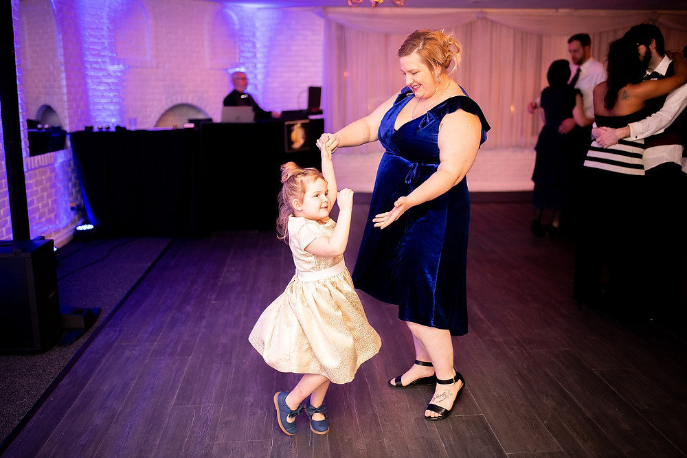 bride and little girl dance at michauds in strongsville ohio