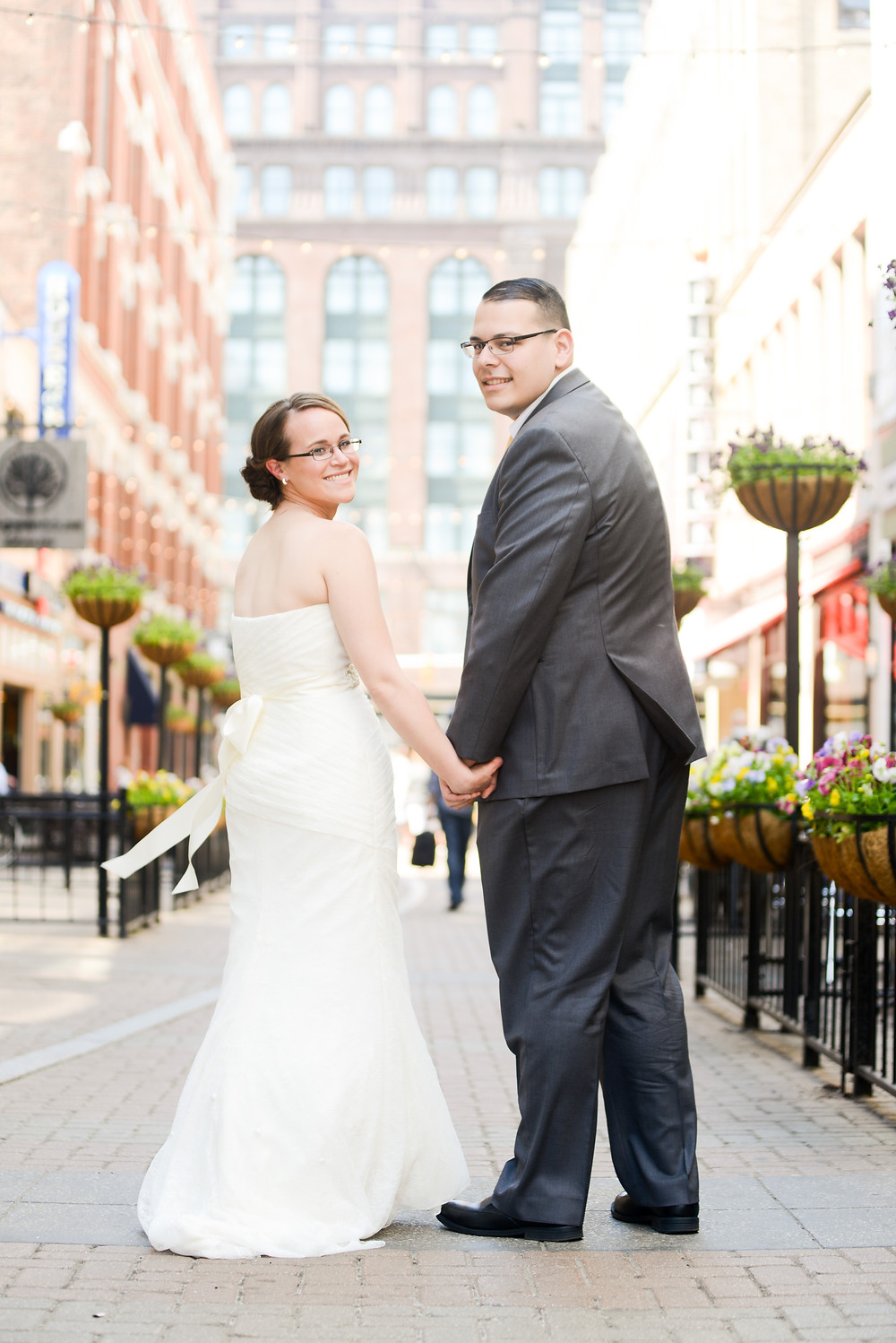 Bride and groom smiling on East 4th Street in Cleveland, Ohio