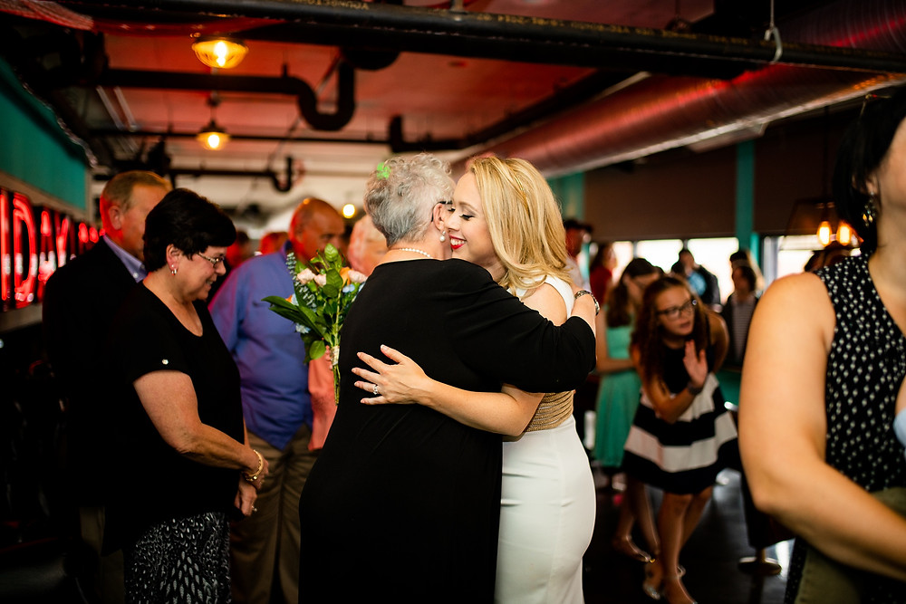 bride hugs guest at punch bowl social in cleveland ohio
