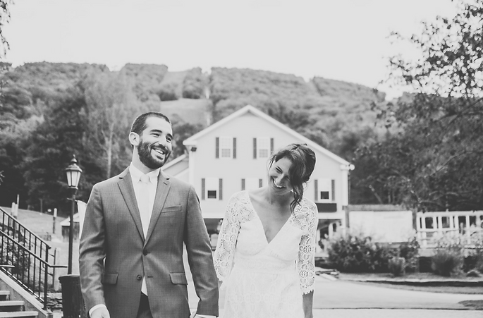 black and white bride and groom portrait holding hands at ski resort