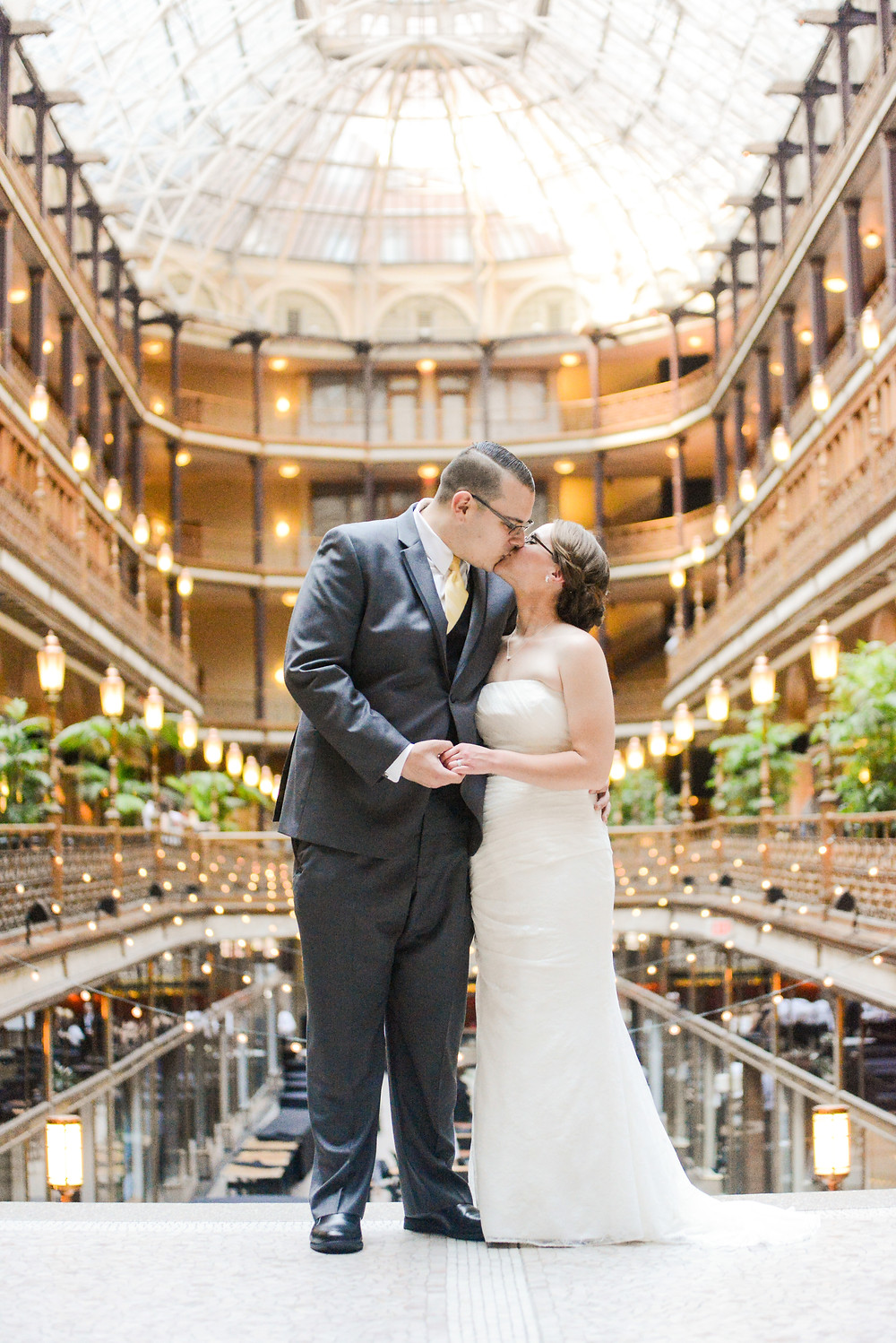Bride and groom kiss in the Cleveland Arcade