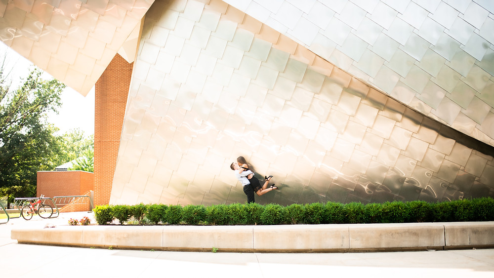 Man and Woman kiss in front of the Peter B. Lewis Building in Cleveland Ohio