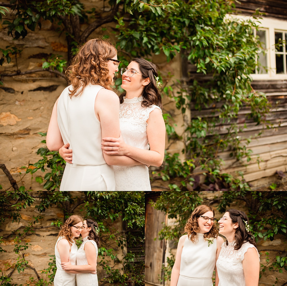 brides embrace and smile on their wedding day