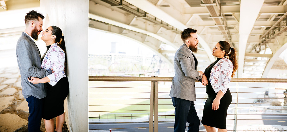Couple pose together in a hug under a bridge in Cleveland, Ohio