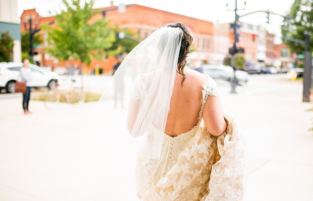 Bride leaves hotel on the morning of her wedding near Oberlin College