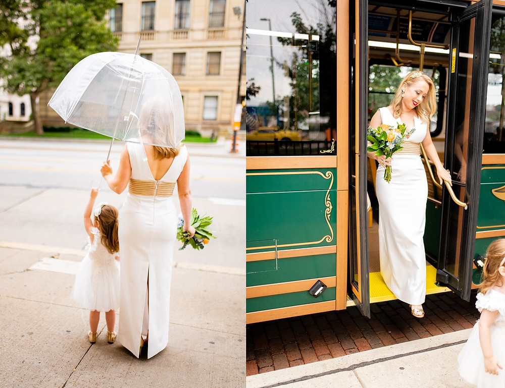 bride and flower girl wait to leave trolly in the flats of cleveland