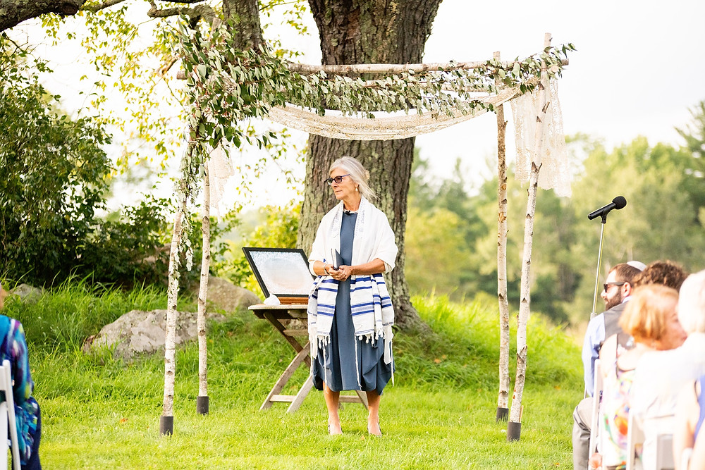 rabbi looks out at ceremony on wedding day