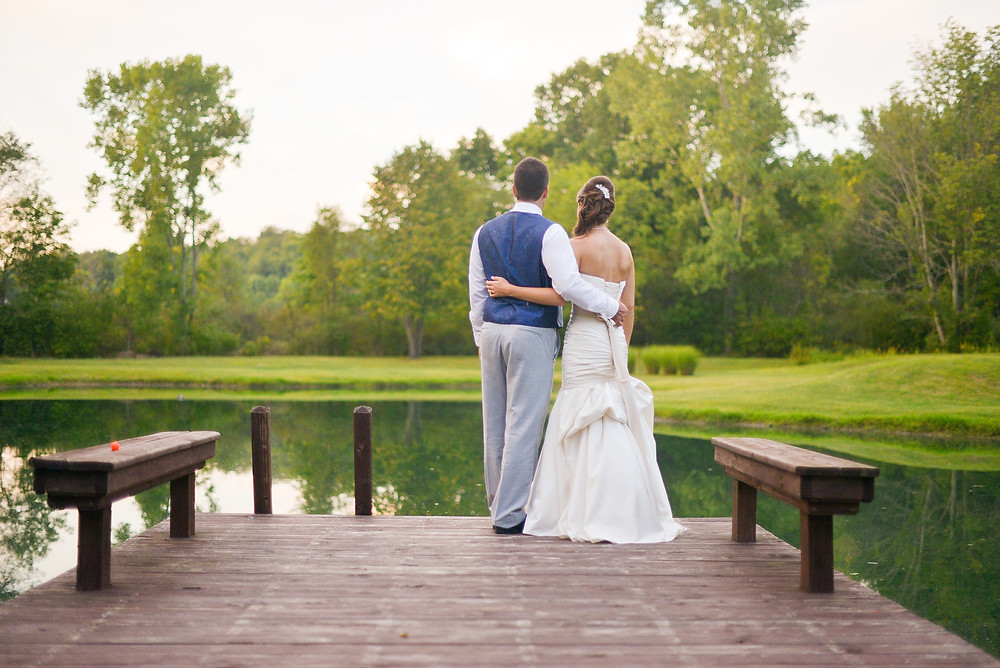 Bride and groom look at Cleveland, Ohio lake