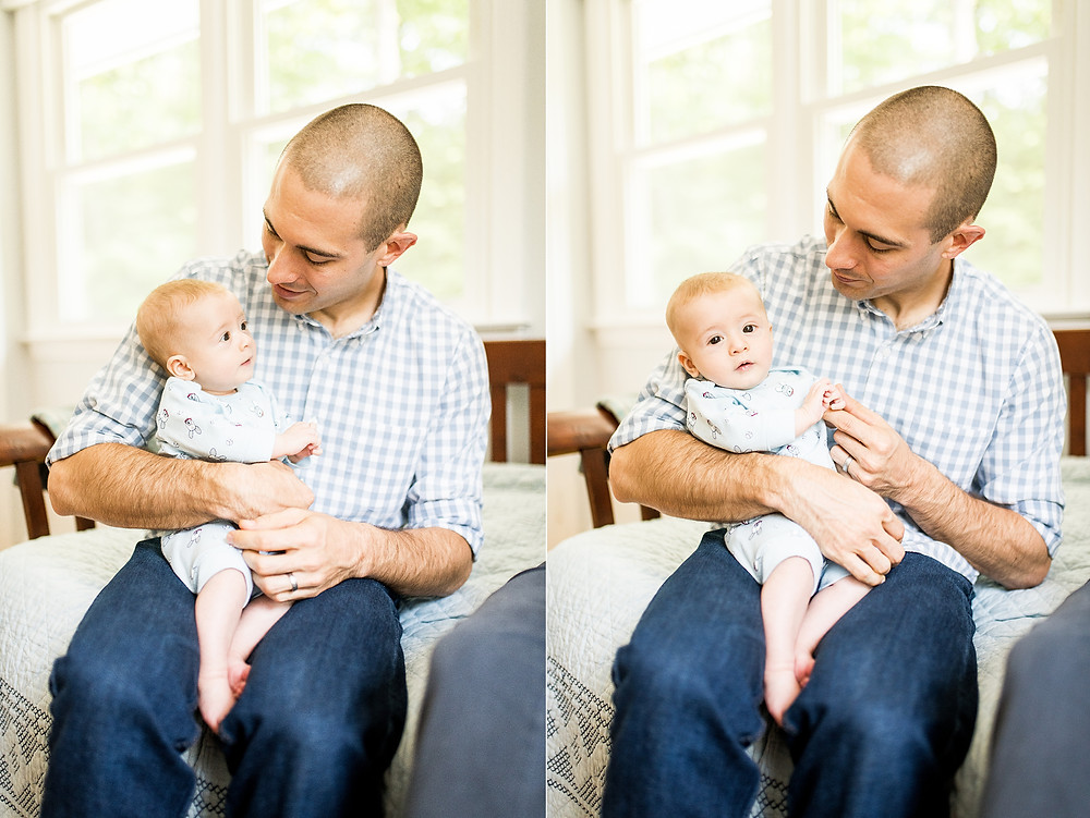 Dad and baby sit together on bed