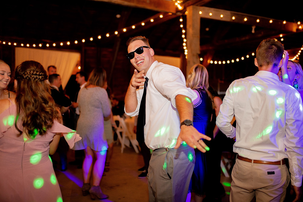 groom dances and smiles on dance floor at wedding near Cleveland Ohio