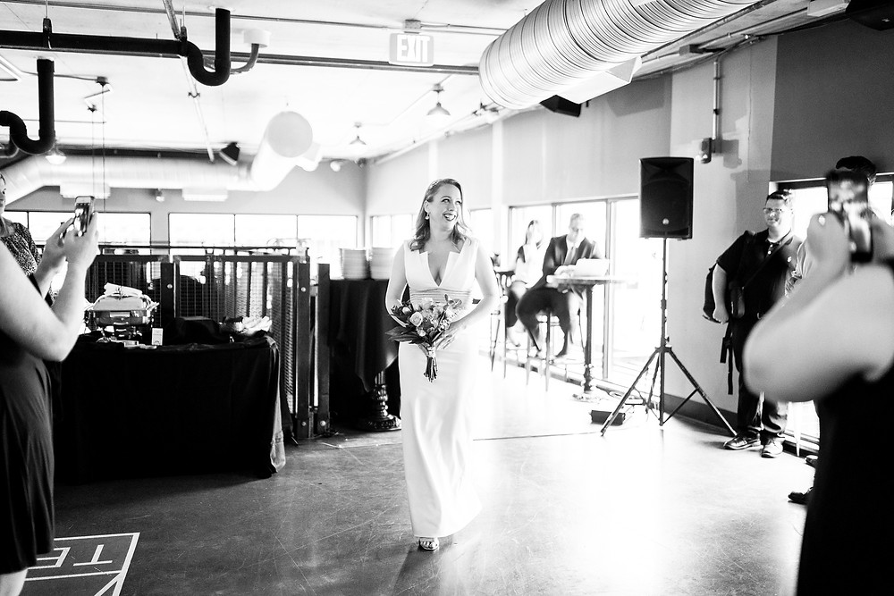 bride enters during wedding at punch bowl social cleveland ohio