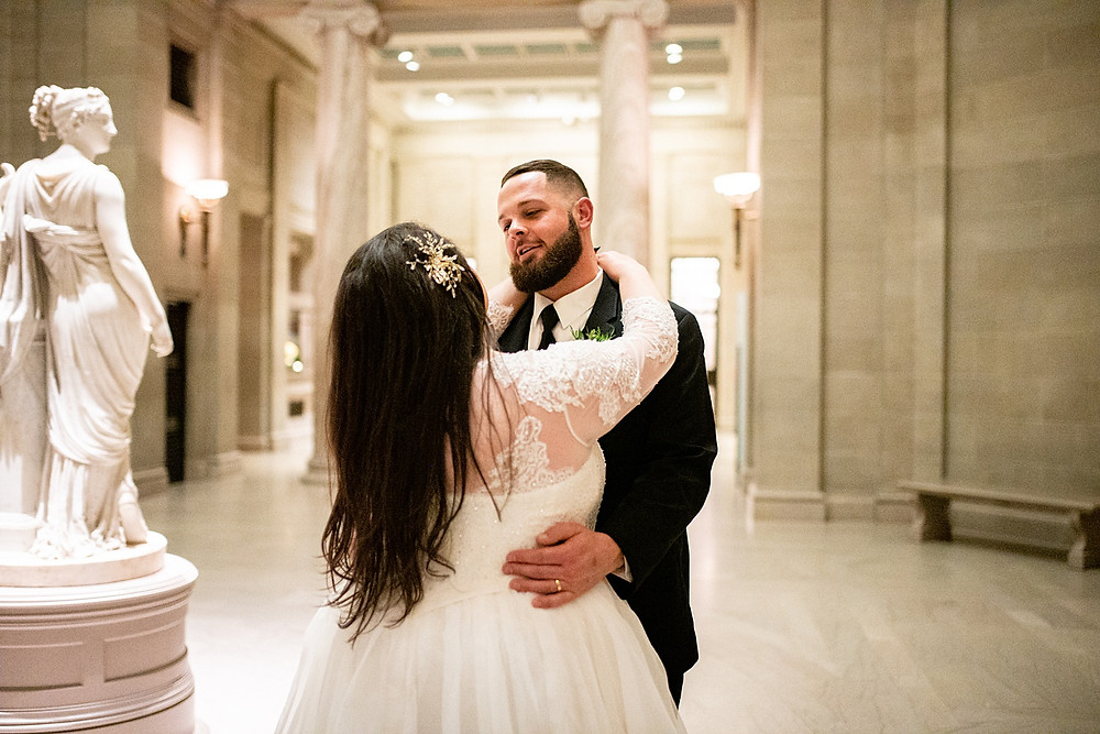 bride and groom dance with one another at cleveland museum of art