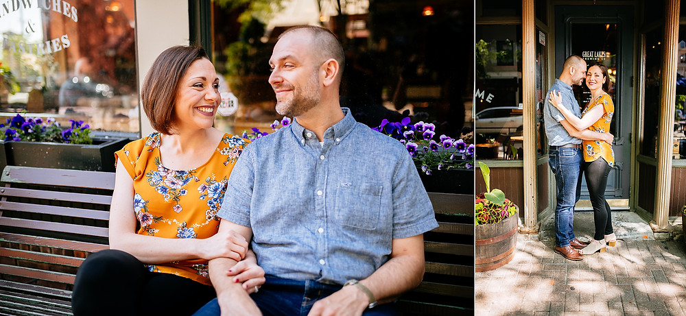 Husband and wife smile and sit on a bench outside of a restaurant in Ohio City