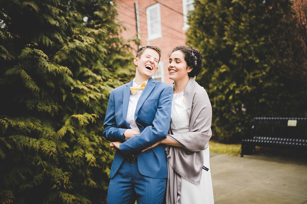 brides laugh and dance on their wedding day