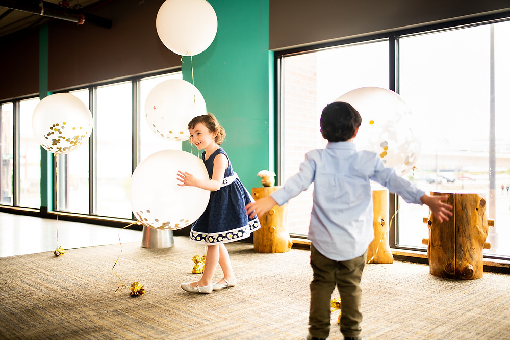 little kids play with wedding day balloons in the flats of cleveland ohio