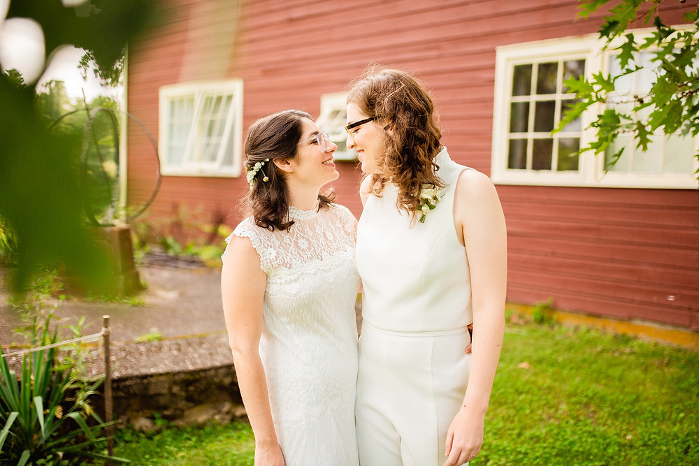 bride and bride look at each other and smile