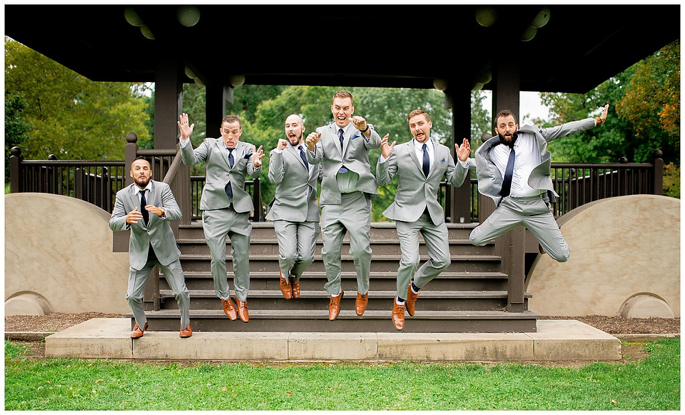 Groomsmen jump in the air during wedding day near oberlin Ohio