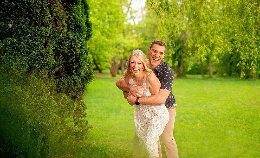 engaged couple hug and laugh during engagement session at gervasi vineyard