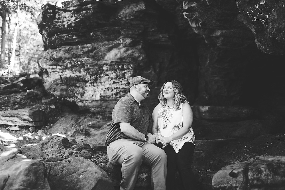 Man and woman sit together at an engagement session in Hinckley, Ohio