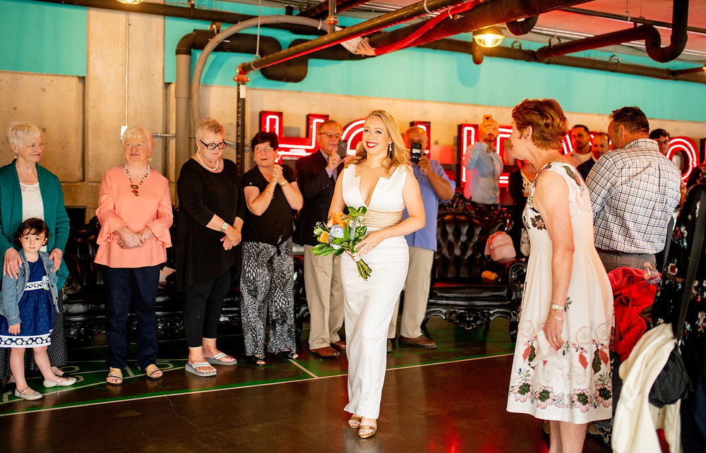 bride smiles widely during wedding at punch bowl social in cleveland ohio