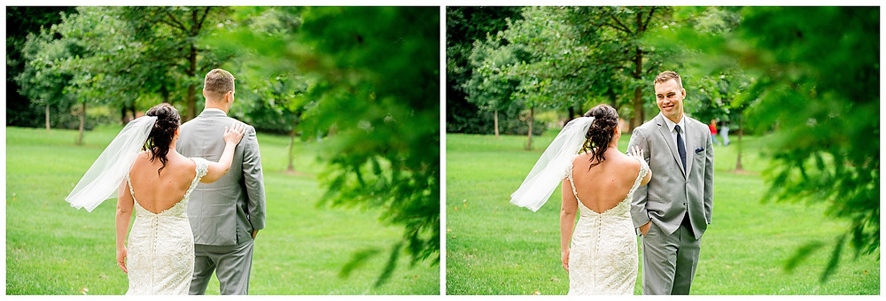 Bride taps groom on shoulder during first-look near Oberlin College