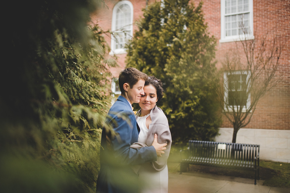 couple holds one another on their wedding day