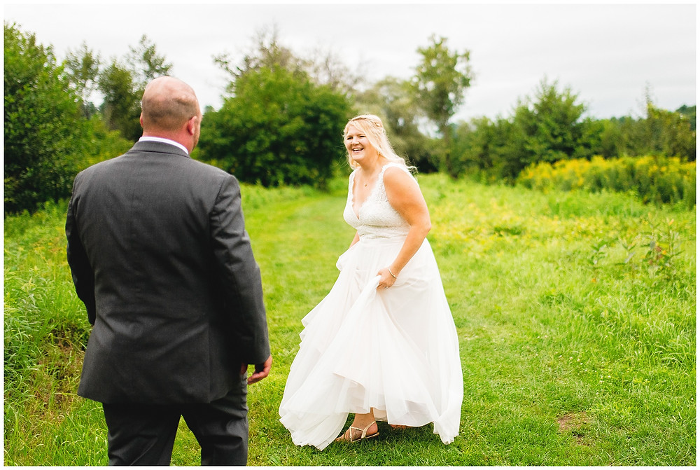 bride and groom dance and play with each other on their wedding day