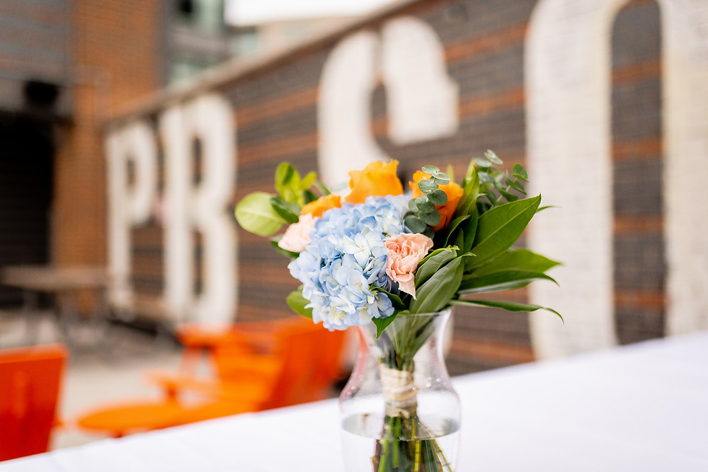 florals sit on table on rooftop bar of cleveland ohio
