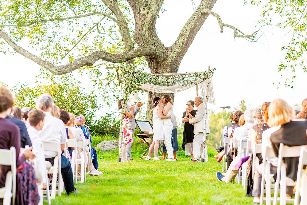brides kiss on their wedding day