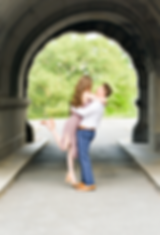 northeast ohio engaged couple hugging under a bridge