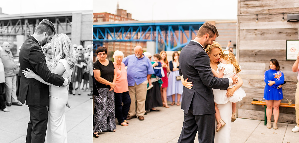 bride and groom slow dance on rooftop of punch bowl social in the flats of cleveland ohio