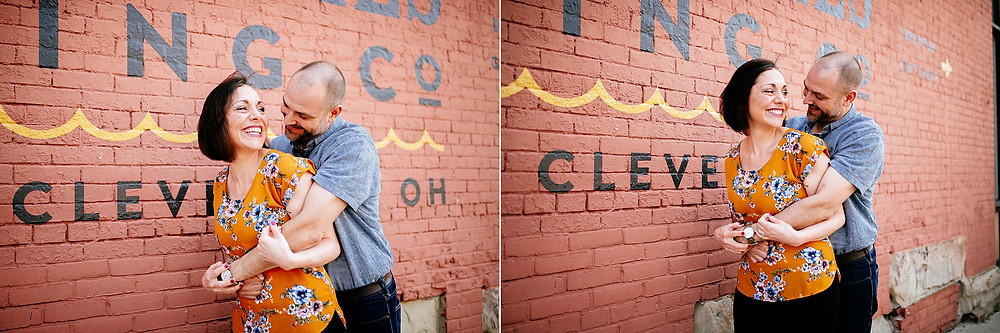 Husband and wife cuddle outside the Great Lakes Brewery mural in Ohio City