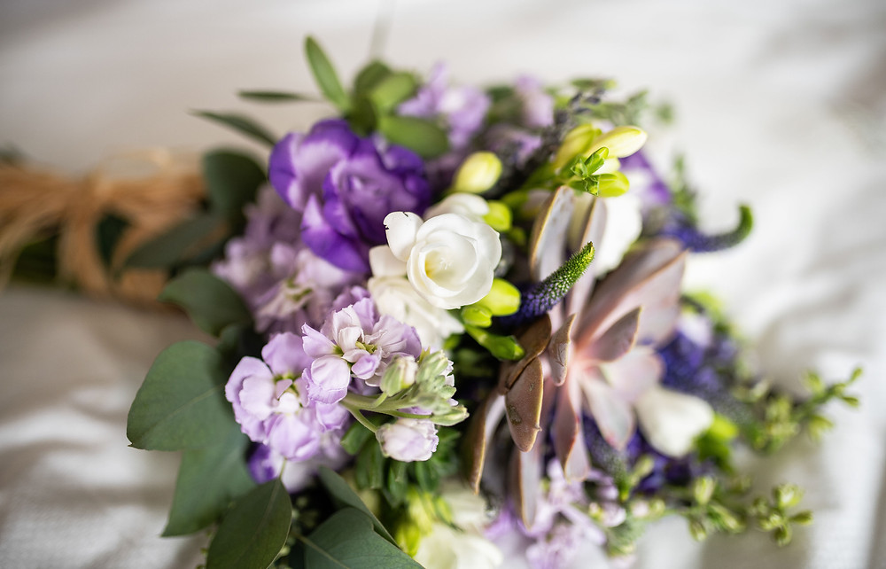purple florals and succulent wedding bouquet in Northeast Ohio