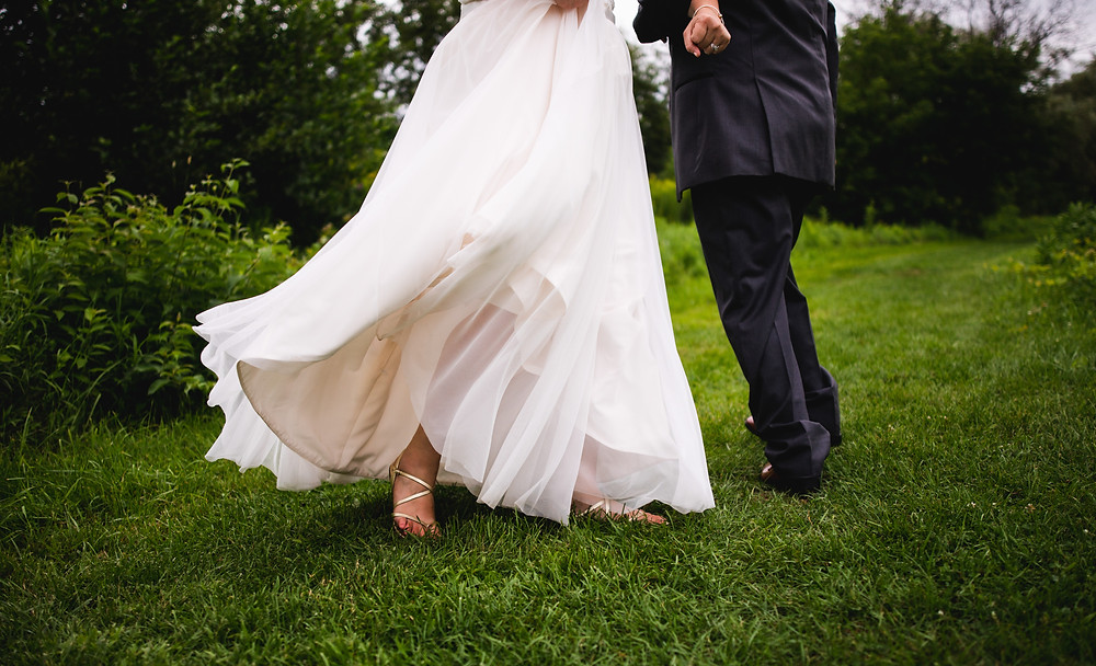 bride and groom attire with tulle dress and strap heels