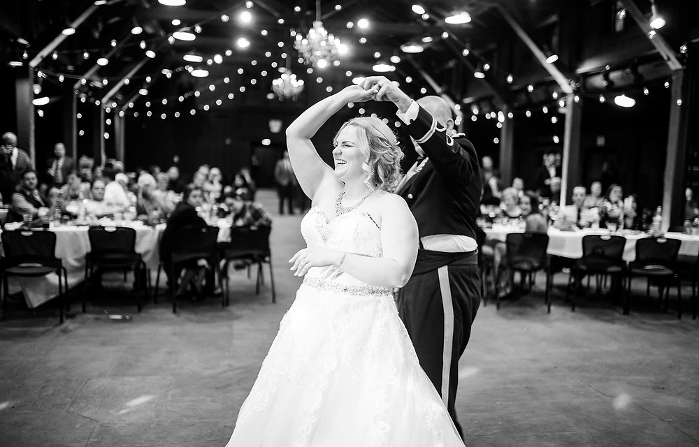bride and groom dance at their wedding reception at the happy days lodge in peninsula ohio