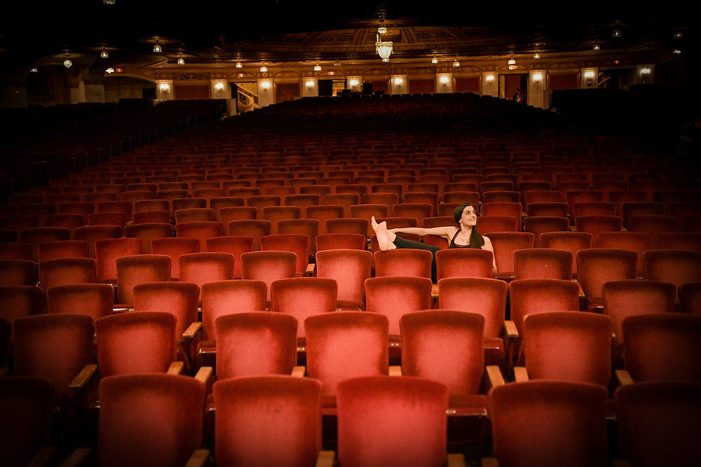 Connor Palace Theater in Cleveland Ohio with lady sitting in seats