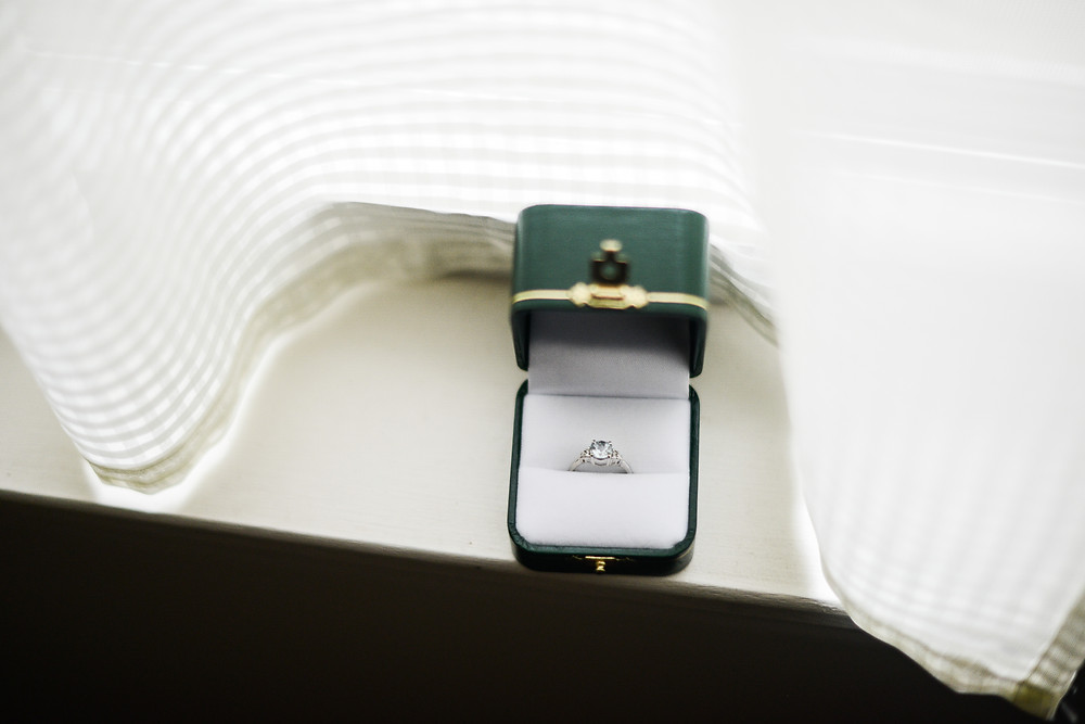 Engagement ring set in an emerald green box on windowsill in Olmsted Falls, Ohio