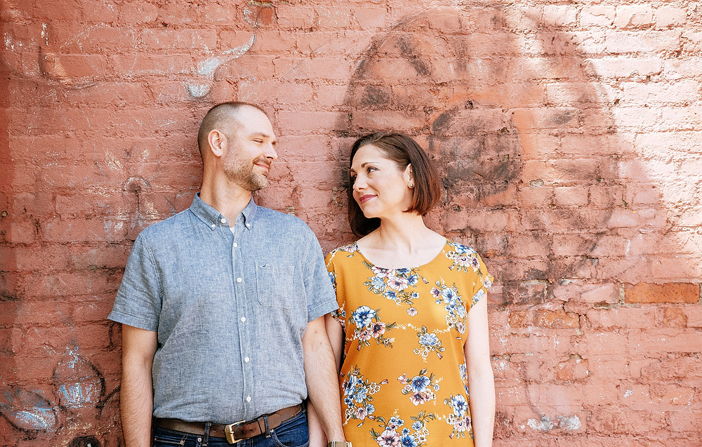 Husband and wife look at each other and smile in Ohio City