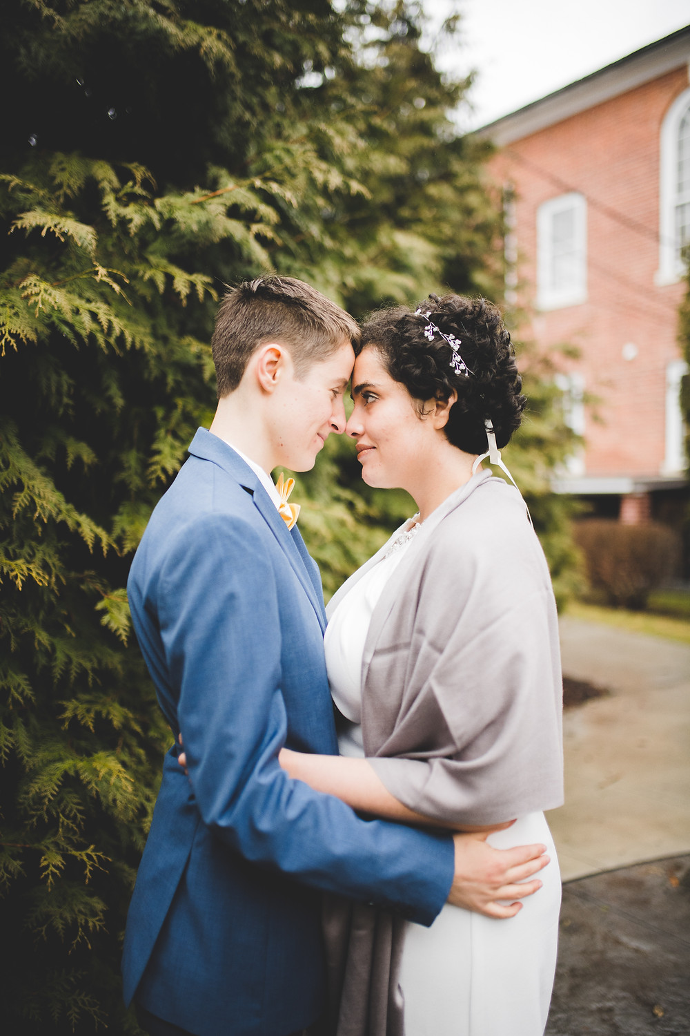 brides embrace holding their foreheads
