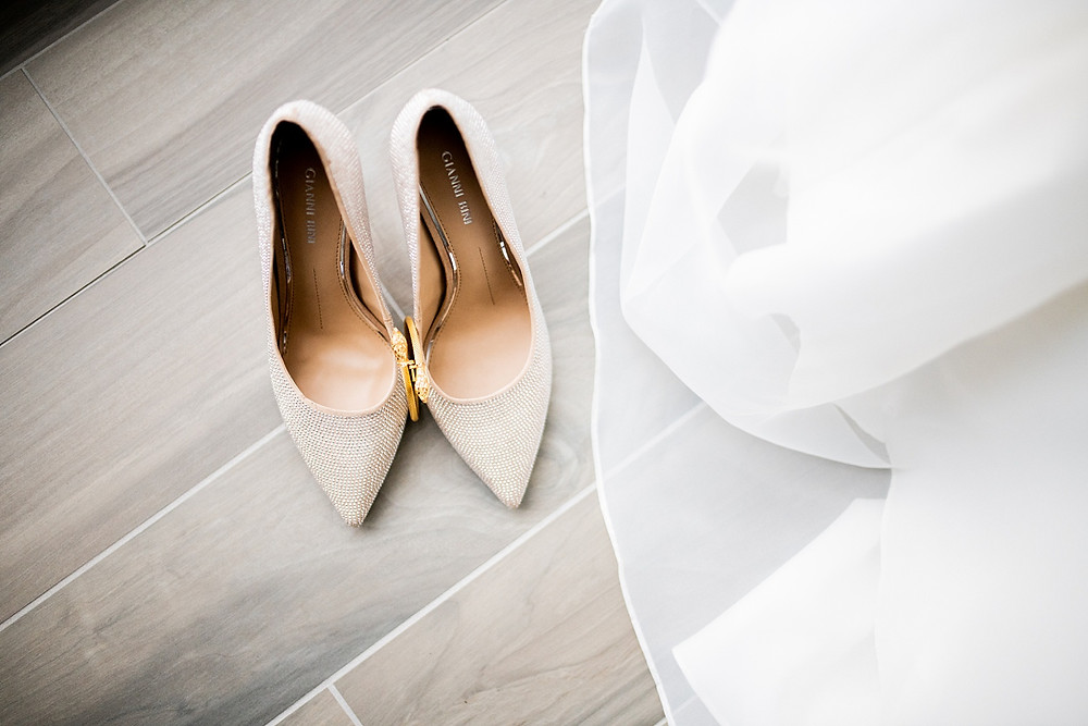 bride's shoes and dress at wedding prep at the downtown hilton in cleveland ohio
