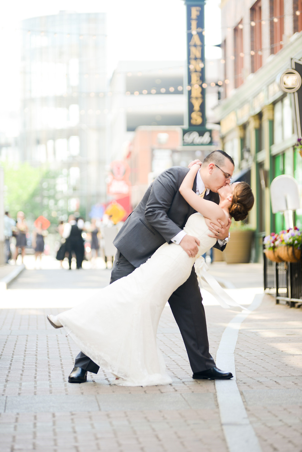 Bride and groom dip kiss on East 4th Street in downtown Cleveland